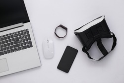 Modern youth gadgets on a white background. Top view. Flat lay