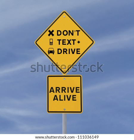 Modified road sign warning of the danger of texting and driving (against a blue sky background)