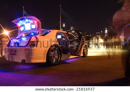 modified white car with several lights and LCD displays
