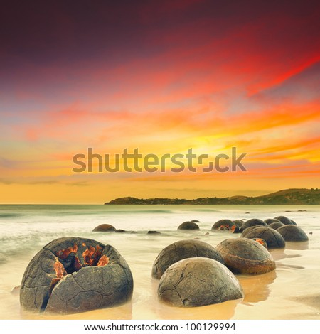 Moeraki Boulders at sunset. New Zealand - stock photo