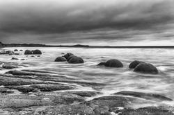 Moeraki Boulders on the Koekohe beach, Eastern coast of New Zealand. HDR image, black and white