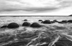 Moeraki Boulders on the Koekohe beach. Eastern coast of New Zealand. HDR image, black and white