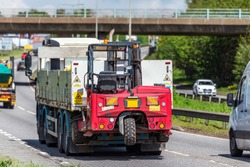 moffet lorry truck with forklift on uk motorway in fast motion