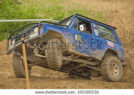 """MOHELNICE, CZECH REPUBLIC - JUNE 10. Unidentified racer at blue off-road car on a steep slope in the """"SHOCK CUP Trial 2012"""" on June 10, 2012 in the town of Mohelnice, Czech Republic."""