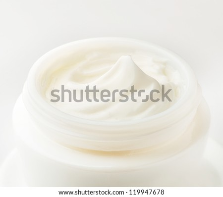 Moisturizing cream in an open jar. Close-up view.