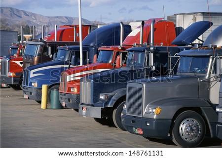MOJAVE, CALIFORNIA - CIRCA 1990\'s: Big rig trucks at truck stop, Mojave, California