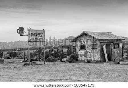 "MOJAVE DESERT, CA, USA - APRIL 6: Abandoned diner along highway Route 66 in Mojave desert on April 6, 2010. Route 66 is a legendary highway called ""Mother road"" in Steinbeck's novel ""Grapes of Wrath""."
