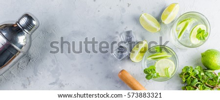Mojito cocktail and ingredients, rustic wood background, copy space #573883321