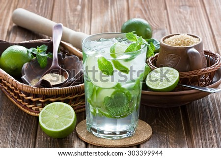 Mojito cocktail delicious summer drink on rustic wooden table