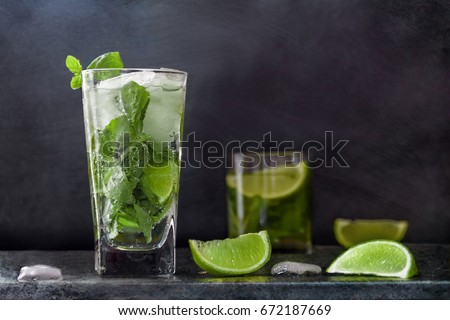 Mojito cocktail drink with lime Ice and mint on dark background with Copy space #672187669