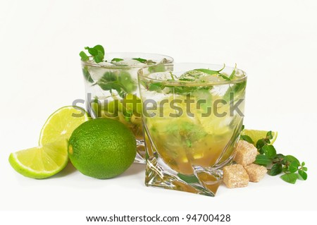 Mojito cocktail  limes and mint isolated on a white background