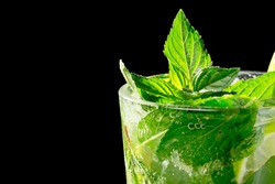 Mojito cocktail on black background