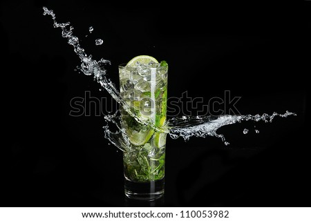 Mojito cocktail on black background with splash