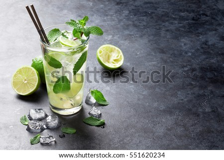 Mojito cocktail on dark stone table. With space for your text  #551620234