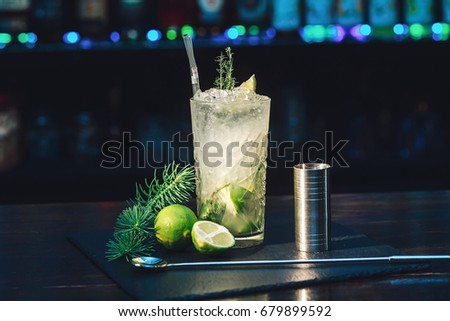 Mojito cocktail on the bar. Rum, lime.