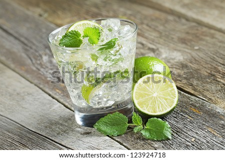 Mojito cocktail on the wooden background - stock photo