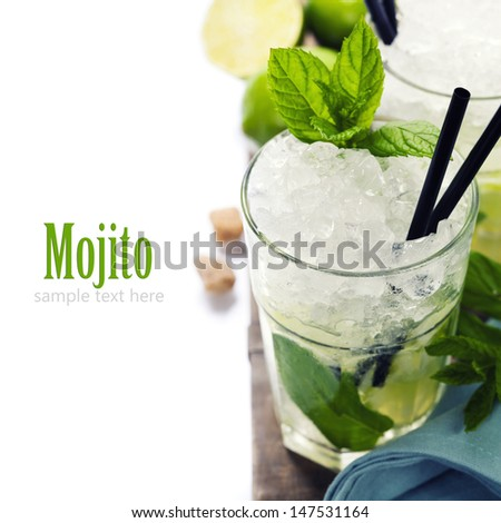 Mojito cocktail with ingredients on wooden background with sample text