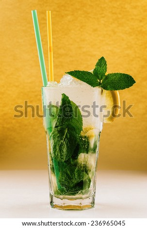 Mojito, glass of water with lemon, ice and mint