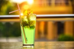 Mojito refreshing drink in a glass. Fresh drink with ice, lime and mint leaves