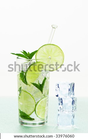 Mojito with ice, lime and mint on frosted glass table