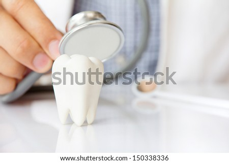 molar with dentist background ,dental concept