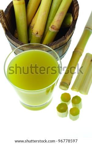 Molasses and sugar cane. - stock photo