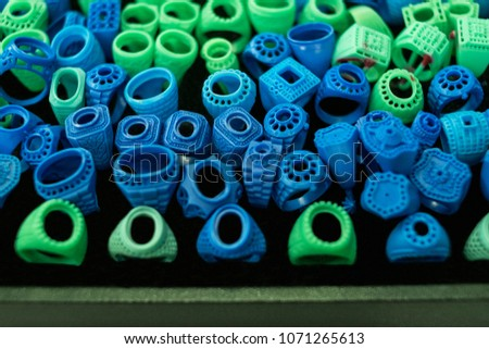 Mold for making ring jewelry. Green and blue mold from wax for ring industrial. tools for jewelry factory. #1071265613