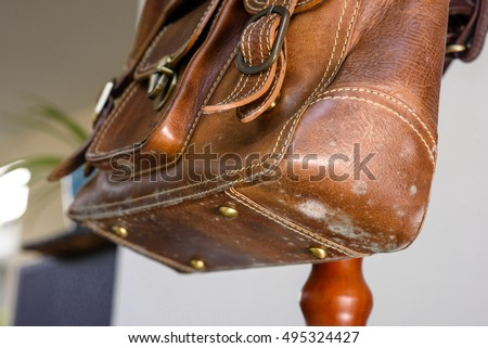mold on old brown leather bag, fungus on leather bag ストックフォト ©