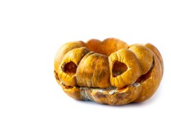Moldy scary Halloween pumpkin with rotten spots on a white background with space for text on the top and left