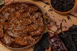 Mole, delicious Guatemalan dessert prepared in the same style as mole poblano in Mexico.