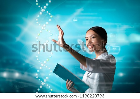Molecular Biology, Genetics and Medical Concept. An Asian woman doctor, scientist or biologist is working in a futuristic, augmented reality virtual space, interacting with a dna sequence.