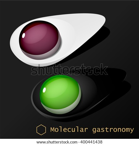 Molecular food balls on white and black spoons isolated on black background #400441438
