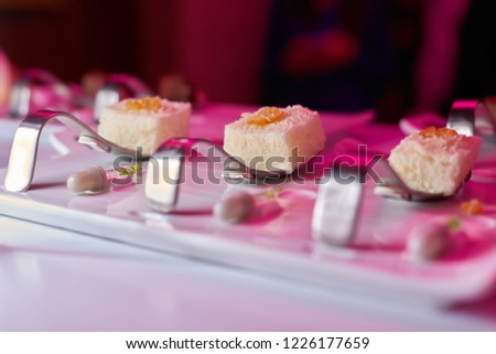 molecular gastronomy elegant white desserts in the spoon