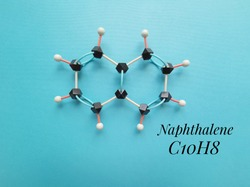 Molecular structure model and chemical formula of naphthalene molecule. Naphthalene is an aromatic hydrocarbon found in coal tar or crude oil, used in the manufacture of fuels, resins, insecticides...