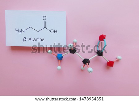 Molecular structure model and structural chemical formula of beta-alanine molecule. β-Alanine is a non-essential amino acid. It is often taken as a sports supplement. Black=C, red=O, blue=N, white=H.