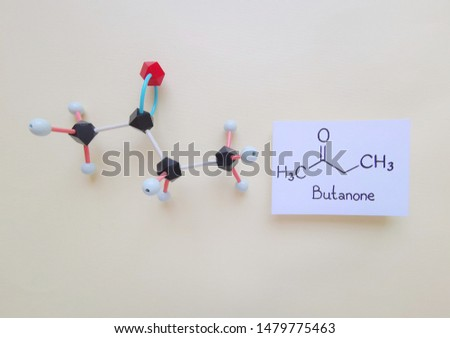 Molecular structure model and structural chemical formula of butanone molecule. Butanone, also known as methyl ethyl ketone (MEK), is an organic compound, a colorless liquid with a sharp, sweet odor.