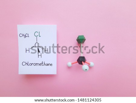 Molecular structure model and structural chemical formula of Chloromethane molecule. Methyl Chloride is a colorless, flammable, toxic gas that is used as a refrigerant. Black=C, green=Cl, white=H.