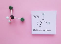 Molecular structure model and structural chemical formula of Dichloromethane molecule. Dichloromethane (DCM or methylene chloride) is an organic compound with the formula CH2Cl2.