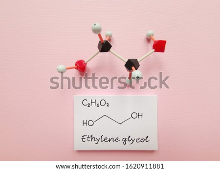 Molecular structure model and structural chemical formula of ethylene glycol molecule. It is used as a raw material in the manufacture of polyester fibers and for antifreeze formulations.