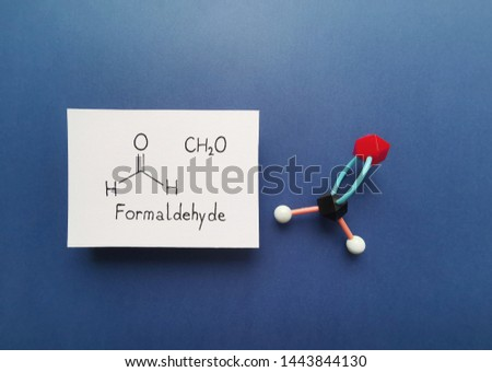 Molecular structure model and structural chemical formula of formaldehyde molecule.  Formaldehyde (methanal) is an organic compound; it is the simplest of the aldehydes. Black=C, white=H, red=O.