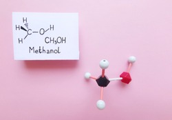 Molecular structure model and structural chemical formula of methanol molecule. CH3OH, ball-and-stick model and skeletal formula. Black=C, red=O, white=H.