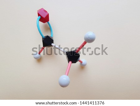 Molecular structure model of Acetaldehyde molecule. Organic molecule Ethanal (CH3CHO). Black=C, red=O, White=H.