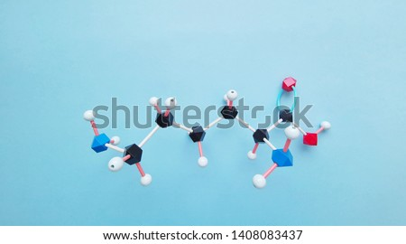 Molecular structure model of essential amino acid L-lysine required for growth and tissue repair. Lysine (L- lysine, Lys, K) amino acid molecule is used in the biosynthesis of proteins.