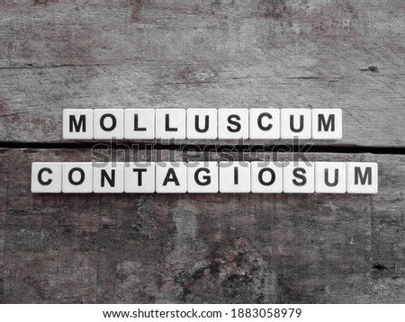 Photo of  Molluscum Contagiosum, word cube with background.