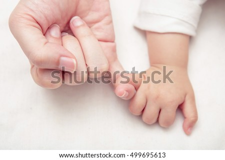 Mom and Baby Hands Promise friendship of generations, New family and baby protection from mom concept