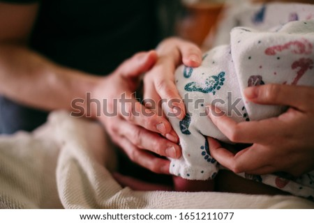Mom and Dad labor together during hard hospital birth in hospital bed Stock photo ©