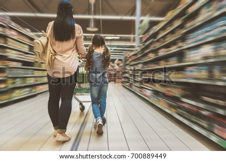 Mom and daughter doing shopping