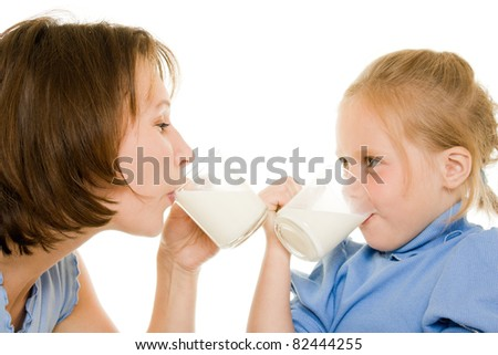Mom and daughter drink milk. - stock photo