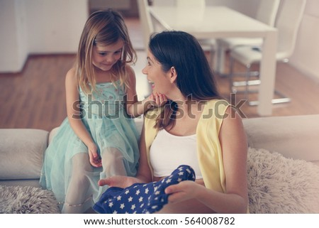 Mom and daughter having conversation.
