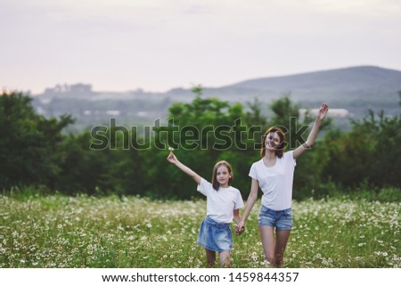 Mom and daughter hold hands nature rest fun joy joy